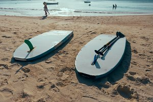 Two surfboard in the sand beach