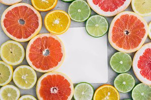 paper sheet with sliced citrus