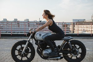 pretty young woman ride motorbike on