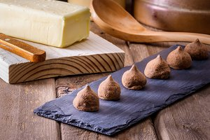 chocolate truffles on wooden table