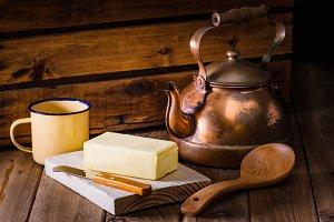 block of fresh butter, kettle, knife
