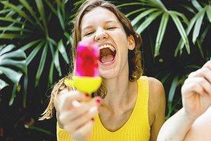 Girl having fun with a posicle