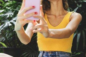 Girl taking a selfie in summertime