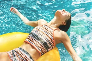 Girl cooling down in a swimming pool
