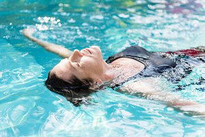 Woman enjoying in a swimming pool