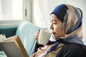 Islamic woman reading a book