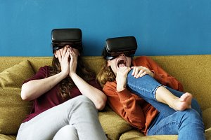 Woman using VR on a sofa