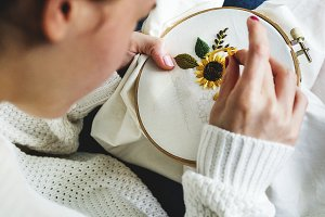 Young girl doing some needlework