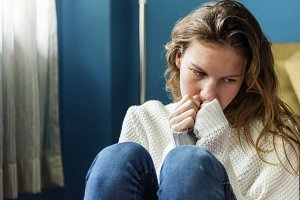 Young alone girl feeling sad