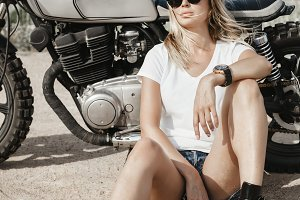 Sexy girl biker and cafe racer