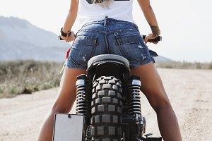 sexy sun-tanned girl biker