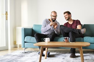Men sitting on couch