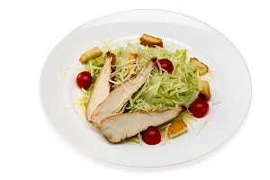Caesar salad with chicken in a plate