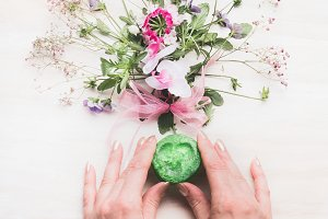 Hands with handmade green soap