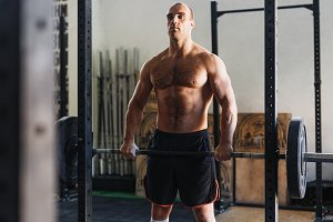 Strong fitness athlete with barbell