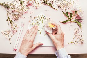 Hands making envelop with flowers