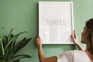 Frame on a green wall (PSD)