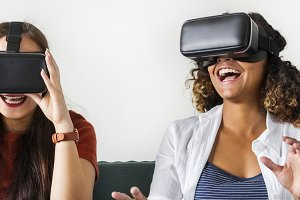 Women with virtual reality goggles