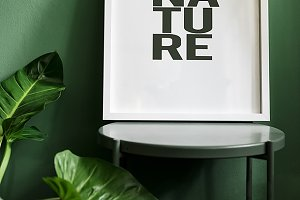 Frame on a a green wall (PSD)