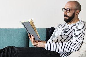 Closeup of man reading a book