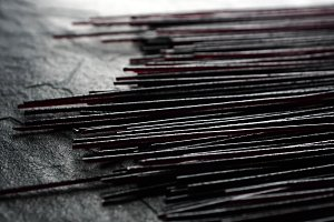 Black dry rice noodles on black stone close-up