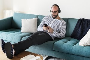 Man using device on couch