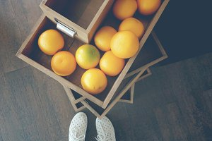 Wooden boxes of oranges