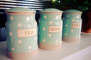 Jars of sugar, tea and coffee