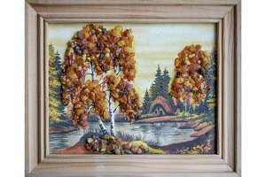 Picture of an amber stone. Crafts made of amber. Landscape house by the river