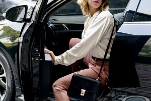 Woman getting out from a car