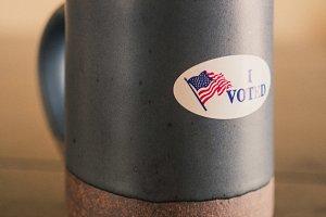 I Voted Sticker on a Coffee Mug