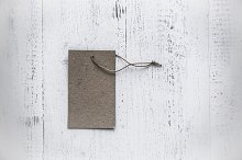 Grey tag tied with string. Price tag
