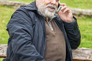 Attractive bearded man talking on ph