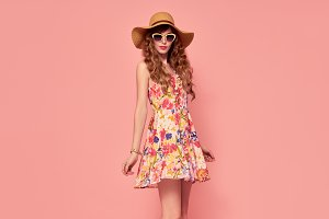 Fashion Young woman.Floral Dress