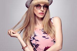 Fashion Blond Girl, Stylish glasses.