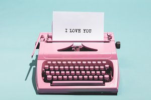 """I love you"" writing and pink typewr"