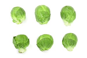 Brussels sprouts isolated on white background closeup. Top view. Flat lay. Set or collection