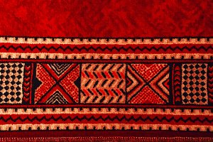 carpet texture. old rug. Red color.