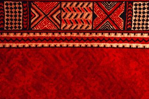 carpet. Red color. geometry. backgro