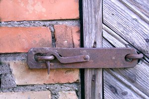 Old lock on the door. true village style .