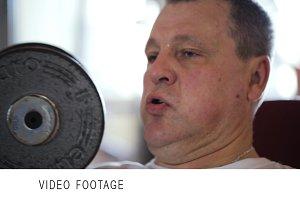 Man lifting dumb-bells