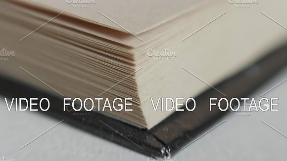 A Man Flips Through Pages In A Book Slowmotion 180fps