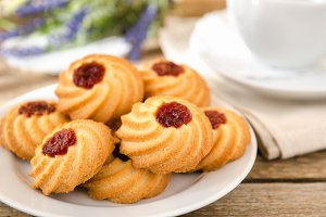 Biscuits with jam on white plate
