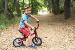 Portrait of a little boy cycling