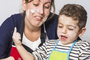 Mother and son making a cake