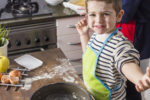 Excited child spotted with flour