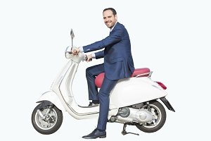 Business man with his white scooter