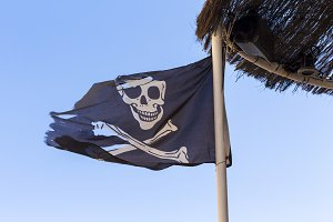 Old and broken pirate flag
