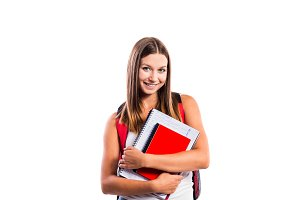 Beautiful student with school books against white background