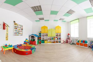 Spacious white game room in the kindergarten. Wide Panoramic Picture.